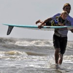 dad and child surfing