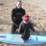 surfer dad and daughter