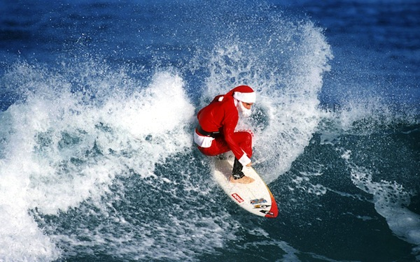 santa surfing good