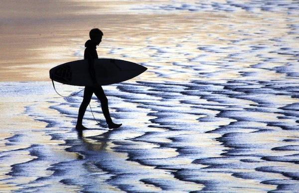 Shoreline surfer silhouette