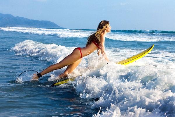 Gisele Bundchen surfing