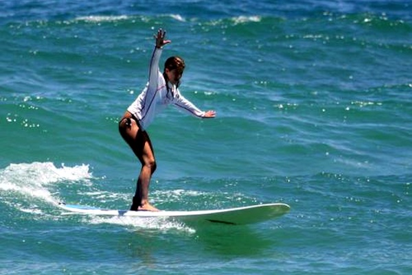 Jennifer Aniston surfing