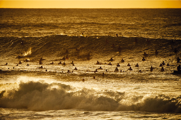 Pipeline crowds surfing sunset