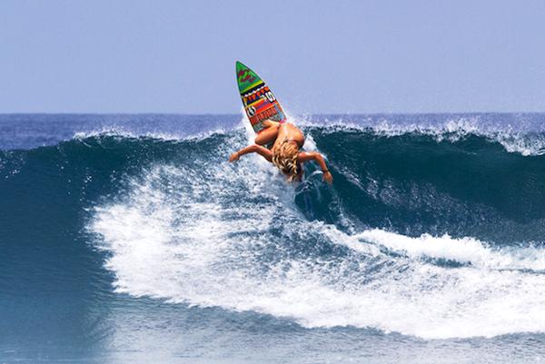 Felicity Palmateer surfing