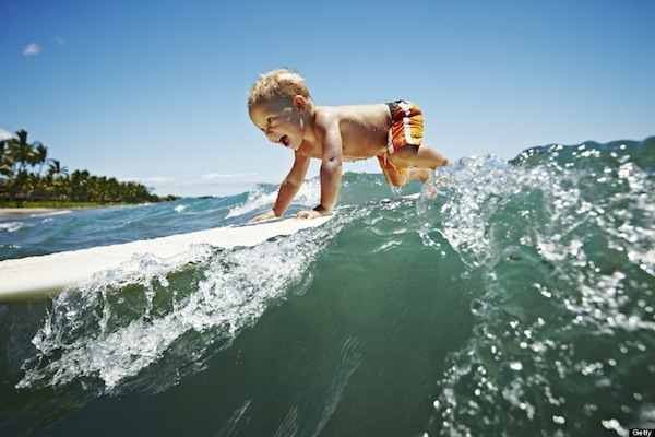young kid surfing