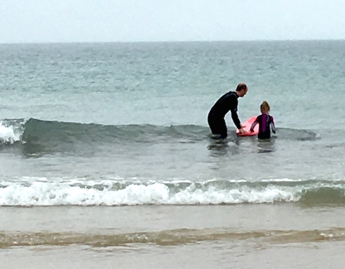 surferdad and daughter small waves