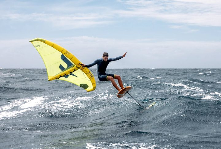 Surfer using a surf wing by F-one kites large