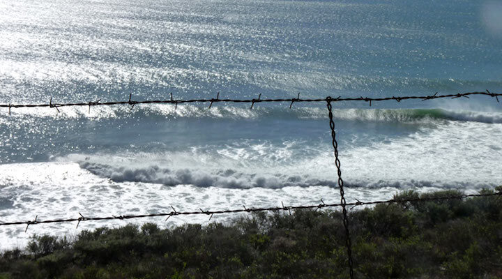 Barbed wire and waves - credit Dave Natal